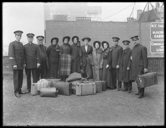 Members of the Salvation Army relief corps about to depart for the Dayton, Ohio flood, March 1913. Appear to be posed on the roof of a building.