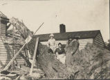 Women surveying damage from a cyclone, Clifton Park NY