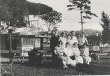 "Concessionaires and wives outside ""Aeroplanes"" attraction at Rexford Park"