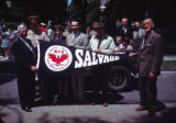 Group with paper salvage banner