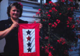 Woman with flag of stars; Mary Marcantonio