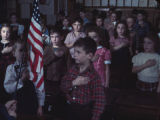Children pledging allegiance to the flag at Broad Street School