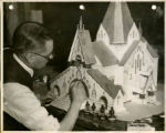 Man painting Holy Trinity model