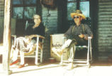 Beede, Alan (Baddy) and sister, Edna Beahan sitting on the porch of Baddy's house
