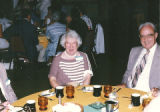 Edmonds, Adrian (1909-2005) and Lu Brown at a party.
