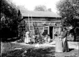 Onondaga Nation: Logan Family in front of hewn timber home