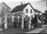 Rudolph Lehne standing with load of willow laundry hampers