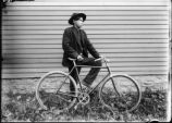 Onondaga Nation: Young man with bicycle
