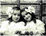 Twin Sisters with Bows.
