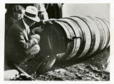 Charles G. Stephens and his barrel