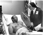 23 Sr. Dorothy Kinniry, DC, with male patient at Lourdes Hospital