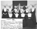 16 Daughters of Charity at Lourdes Hospital wearing the original habit with white cornettes