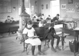 Children reading at Morton School