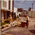 Chemung Valley Savings & Loan clean-up pile of debris [1972]