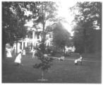 Rose Hill Mansion; children playing croquet on front lawn
