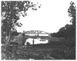 Bridge over the outlet of Seneca Lake with carriages and horses on it, road and railroad bridges,...