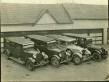 [Four Fulton Funeral Home Vehicles]
