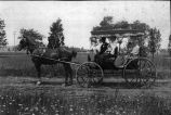 [Gilbert Family in a Carriage]