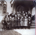 [Children and the Minister in Front of the Presbyterian Church]