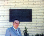 [Guy Lombardo in Front of Plaque on Building]