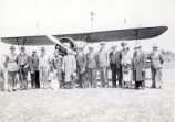 [Biplane with Pilot and Group]