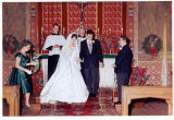 [Bride and groom at the altar]