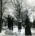 [Four young people in snow]