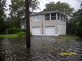 [Flooded house]