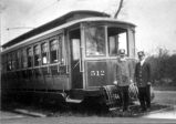 Closed electric trolley car.