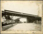 Manhattan: Manhattan Street [i.e. 125th Street] looking east under the elevated viaduct over...
