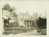 Brooklyn: double exposure--yellow house on the north side of 84th Street, east of Bay 16th, built...