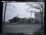 Bushwick: unidentified wooden buildings with water or oil tank in background, undated.