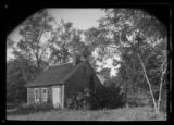 Amagansett / Wainscott, Long Island: [unidentified small wood-shake house amid trees, undated.]