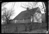 East Hampton, Long Island: [rear view of unidentified old saltbox house faced in shakes and planks...