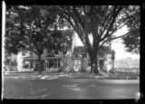 [Unidentified Dutch-style, heavily shaded house, undated. Front view.]