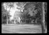 [Unidentified Dutch-style, heavily shaded house, undated. 3/4 view.]