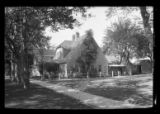 [Side view of unidentified suburban  house, undated.]
