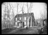 [Unidentified wood-shake saltbox house in good repair, undated. White trim, car parked in...