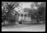 [Unidentified mansion with Grecian columned entry and widow's walk,  surrounded by fence, undated.]
