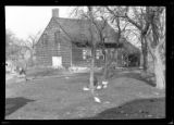 [Unidentified wood-shake Dutch farmhouse with open shed on one side, stone patch in side wall,...