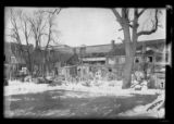 [Brooklyn: unidentified old wooden houses and yards, undated. Elevated train visible above and...