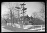 [Unidentified large Dutch Colonial house in good repair, with rectangular double windows, white...