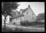[Unidentified annex to larger building, Dutch farmhouse style with three dormer windows and a...
