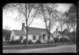 [Unidentified suburban Dutch Colonial house with arched entry, undated.]