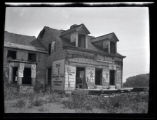 Newtown: [unidentified house, gutted and covered in bills, undated.]