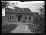 Newtown: [unidentified old wood house, gutted, undated.]