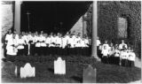 Manhattan: St. Paul's Chapel choir and Rev. Dr. Kemp posed in front of the churchyard portico,...