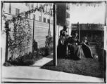 George P. Hall family in the backyard of  642 Putnam Avenue, Brooklyn, undated. May Rebecca Hall,...