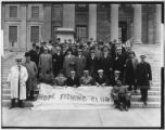 Members of the Hope Fishing Club on the steps of an unidentified building, 1911.