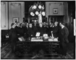 Corporate presentation (photo-op) in unidentified office (Arnold-Mutual Life Group?), undated (ca....